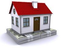 Haus auf einem Bündel Dollar Lizenzfreies Stockbild