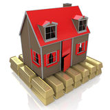 Haus auf Goldbarren Stockfotos