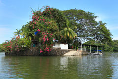 Haus auf Insel stockbilder