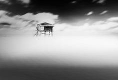 Haus auf Meer Stockbild