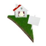 Haus auf Stück Land mit Gras Stockbild