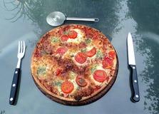 Haus bildete Pizza Stockfotos