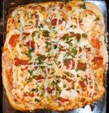 Haus bildete Pizza Stockbild
