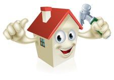 Haus, das Hammer hält Lizenzfreie Stockbilder