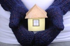 Haus in der Hand Stockfoto