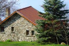 Haus in der Landschaft Stockbild