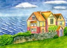 Haus durch das Meer Stockfotografie