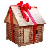 Haus in einem Geschenk Stockfotografie