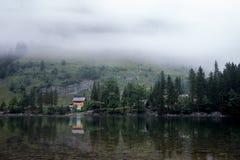 Haus f.m. ser mit Spiegelung Appenzell Schweiz royaltyfri fotografi