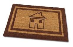Haus-Fußmatte Stockfotos