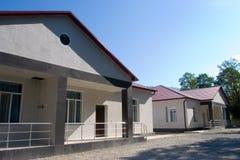 Haus in hölzernem und in Blauem stockfotografie