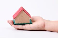 Haus an Hand Stockfoto