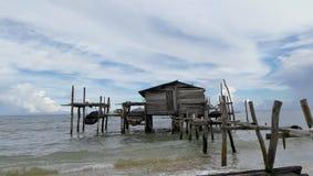 Haus im Meer stockfotografie