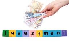 Haus-Investition in den Spielzeugzeichen Stockbild