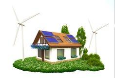 Haus mit Dachspitzensonnenkollektoren und -Windkraftanlagen Stockfoto