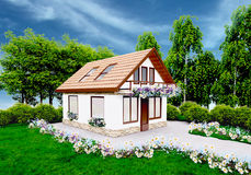 Haus mit den Blumen, die auf dem Gras stehen Lizenzfreie Stockfotografie