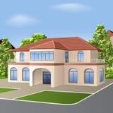 Haus mit einem mit Ziegeln gedeckten Dach, Fenstern und Eingang Lizenzfreie Stockfotos