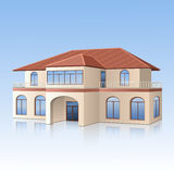 Haus mit einem mit Ziegeln gedeckten Dach und einer Reflexion Stockfotografie