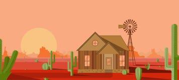 Haus mit einer Mühle in der roten Wüste lizenzfreie stockbilder