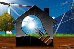 Haus mit Glühlampe und erneuerbaren Ressourcen Lizenzfreie Stockfotos