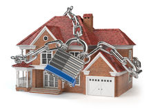 Haus mit Kette und Verschluss Konzept des inländischen Wertpapieres stockbild