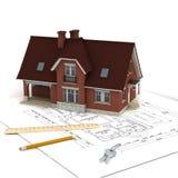 Haus mit Projekt und Tasten Lizenzfreie Stockbilder