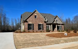 Haus mit Rasen Lizenzfreies Stockfoto