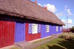 Haus mit Strohdach. Stockbilder