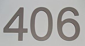 Haus oder Hotelzimmer nummeriert auf klarer grauer Oberfläche, für grafisches Konzept Lizenzfreies Stockfoto