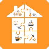 Haus-Puzzlespiele mit Reparaturwerkzeugen Stockfoto