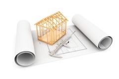 Haus-Rahmen mit Tasterzirkel über Architekten Blueprints stockbild