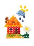 Haus, süßes Haus - Kindgeleebohnenfertigkeit Stockbild