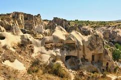 Haus schnitzte in der typischen Felsformation in Cappadocia, die Türkei Stockfotos