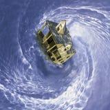 Haus in spinnendem Strudel Stockfotos