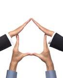 Haus-Symbol gebildet von Hands Lizenzfreies Stockbild