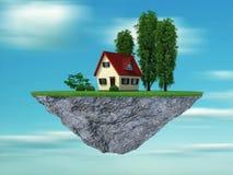 Haus und Bäume auf einem Klippenhängen Stockfotografie
