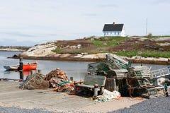 Haus und Dock in Peggy Bucht Stockbild