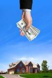 Haus und Hand Stockbild