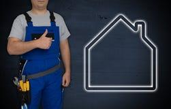 Haus und Handwerker mit den Daumen oben stockbilder