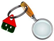 Haus und Lupe Lizenzfreie Stockfotos
