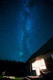 Haus und Nachtstern Stockfotos