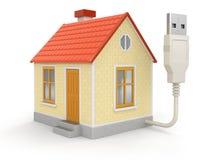 Haus und USB-Kabel Lizenzfreies Stockfoto