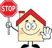 Haus-Zeichentrickfilm-Figur, die ein Stoppschild hält Lizenzfreie Stockfotos