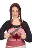 Hausfrau, die ein Messer schärft Stockbilder