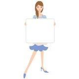 Hausfrau, die ein weißes Brett hat Lizenzfreie Stockfotos