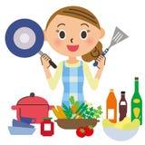 Hausfrau, die kocht Stockbild