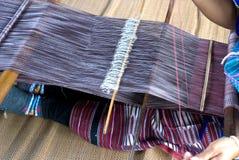 Hausfrauwebart-Baumwolltuch in Thailand Stockbilder