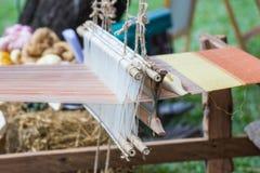 Haushalts-Webstuhlspinnen - Detail des spinnenden Webstuhls Stockfotos