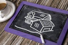 Haushand gezeichnet auf Tafel Lizenzfreie Stockbilder