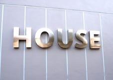 Hausmarke mit glatter Linie Hintergrund Stockfotografie